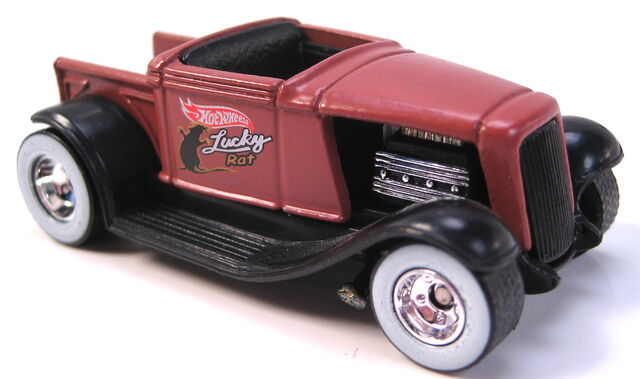 File:Hooligan bron primer WW real riders on chrome rims pops garage 4 car set 2002.JPG