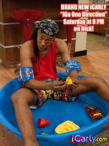 File:T-bo in a baby pool.jpg