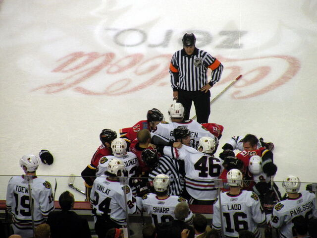 File:Blackhawks-Flames scrum.JPG