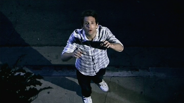 File:5x10 Dennis at window.png
