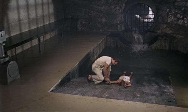 File:Dr. No - Bond rescues Honey.png