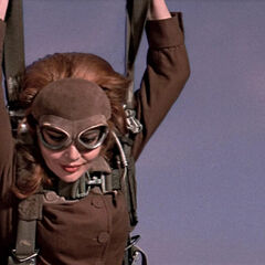 Helga parachutes out to safety, convinced she has succeeded her mission to kill 007