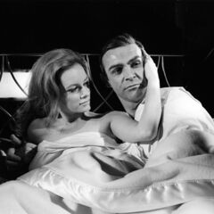 Promotional photograph of Luciana Paluzzi and Sean Connery on set.