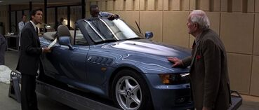 GoldenEye - Q demonstrates the BMW Z3