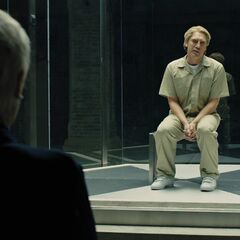 M confronts the imprisoned Raoul Silva in <i>Skyfall</i>.