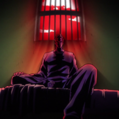 Angelo in a prison cell.