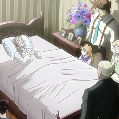 Erina lying peacefully on her deathbed with family at her side