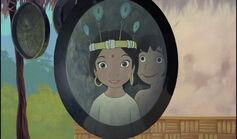 Shanti is happy to wear a feather hat Mowgli gave her