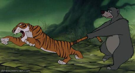 Baloo the Bear holds onto Shere Khan the Tiger's tail