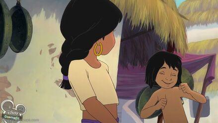 Shanti is watching Mowgli dance