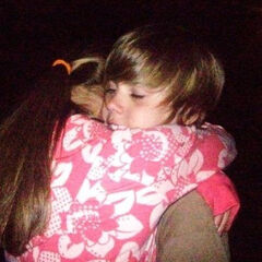 A picture of them hugging at Justin's 'going away' party