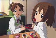 Ui and Yui eating takoyaki