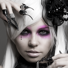 The marks appear vertically under Kerli's right eye.