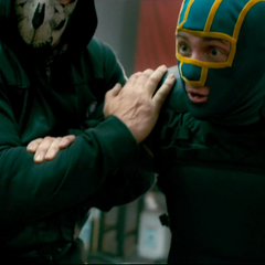 Kick-Ass being held captive by two supervillians