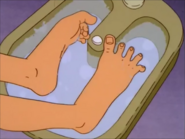 Peggy lifts her Feet out of the Foot bath