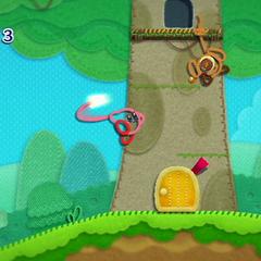 Kirby usando su látigo junto a un Uki.