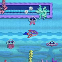 Kirby con forma de Delfín en el agua.