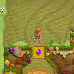 Kirby en forma de pesa de 2 toneladas, a punto de impactar.