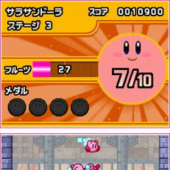 Varios Kirby luchando contra un gran enemigo.