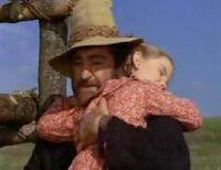 Laura and Mr. Edwards hug