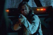 Desmond Hume with an AK-47