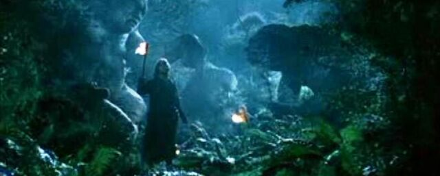 File:Aragorn and company near a troll that turned into a stone 01.jpg