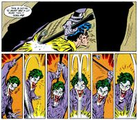 The Joker beats Robin brutally with a crowbar.