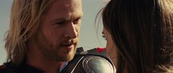 Thor looks at Jane