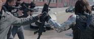 Bucky taking a gun
