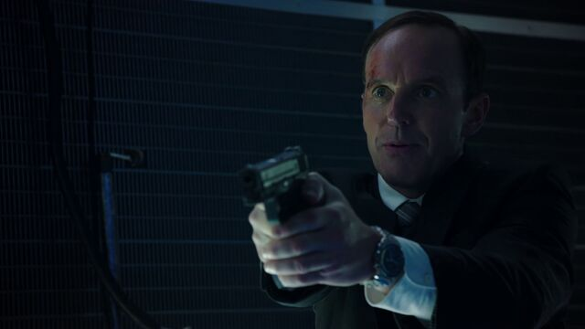 File:Coulson pistol the asset.jpg
