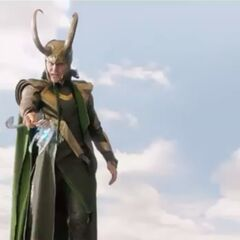 Loki pointing his weapon at Thor.