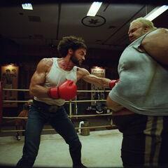 Wolverine gut punches Blob