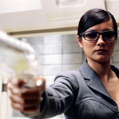 Lady Deathstrike wielding a tranquilizer gun