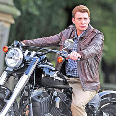 Rogers arrives at central park on his motorcycle.