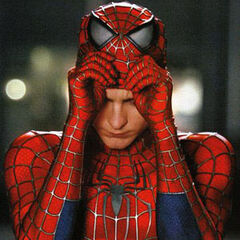 Peter puts his Spider-Man mask on.