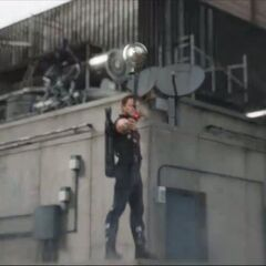 Hawkeye shooting an arrow.