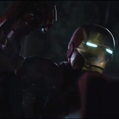 Thor crushing Iron Man's armor.