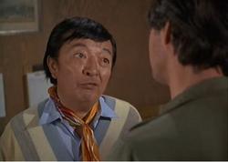 Charlie Lee talking to Hawkeye
