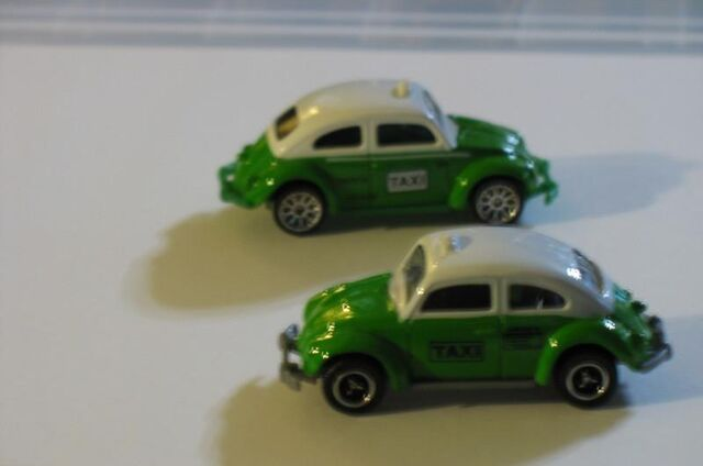 File:VW BEETLE TAXIS GREEN WHITE VARIATIONS.jpg