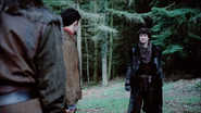 Mordred walks up to Merlin