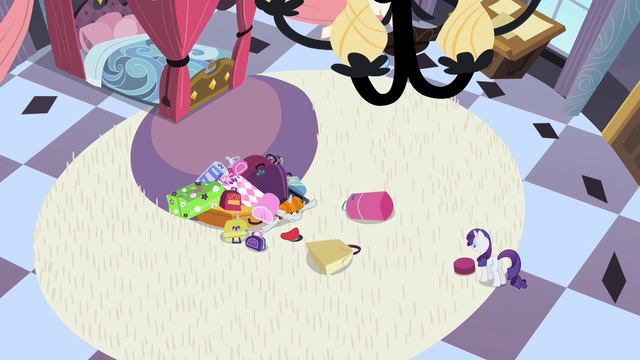 File:Bellhop buried under Rarity's luggage S2E09.png