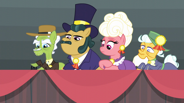 File:Row of rodeo school judges S5E6.png