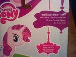 Twinkleshine with Rarity's model merchandise