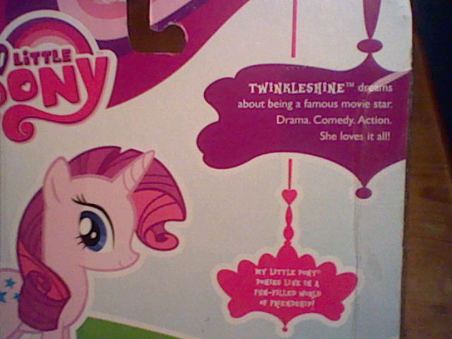 File:Twinkleshine with Rarity's model merchandise.jpg