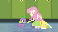 Fluttershy feeds Spike a dog biscuit EG