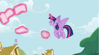 Twilight Sparkle flying up to Rainbow Dash S4E21