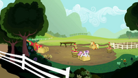 Sweetie Belle lying on a hay bale S2E5