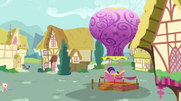 Twilight climbing into the Twinkling Balloon basket S5E23