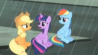 Twilight, Rainbow and Applejack sitting on the street S4E08