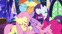 Twilight and her pony friends group hug EG2